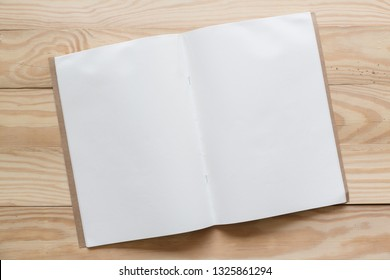 Abstract Blank one white paper on wooden table top view background concept for empty letter business sheet, plain mock up education template, flyer card, notebook frame notepad back to school.