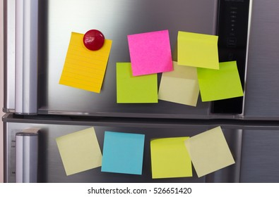 Abstract of Blank paper and post-it on refrigerator door.