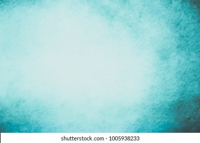 abstract blue background with border and light center and soft pastel vintage grunge texture design old antique blurred