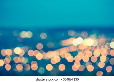 abstract blue circular bokeh background, city lights with horizon, toned style,