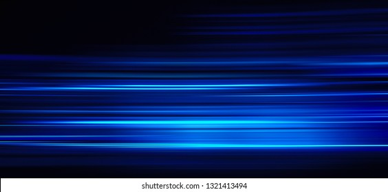 Abstract blue light trails on the dark background