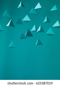 Abstract blue  paper pyramid background in space. Copy space available. Usefull for business cards and web