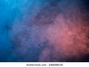 Abstract blue and pink smoke on a dark background. Blue smoke background