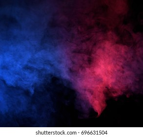 Abstract blue and pink  smoke on a dark background. Blue and pink  smoke background