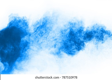 Abstract blue powder splatted background,Freeze motion of color powder exploding/throwing color powder,color glitter texture on white background.