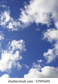 an abstract blue sky background with fluffy white clouds