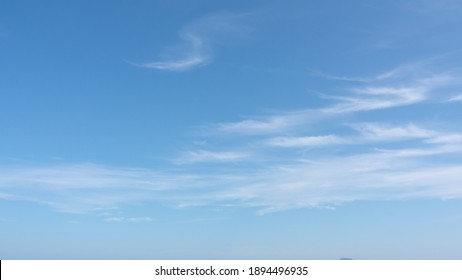 Abstract blue sky transparent cloud background screen. skycaps on a sunny day. white cumulus wispy clouds moving on clear weather in the summer season. panoramic view of nature.