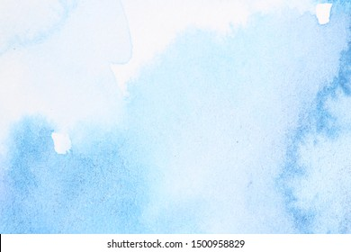 Abstract blue watercolor with stains. Blue and turquoise background with empty space for text.