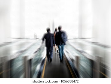 abstract blue zoom shot. Back of businessman talk and walk on elevator to entrance of modern building. Business talking on walkway with partner. Communication concept
