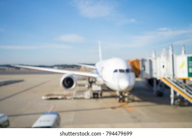 Abstract blur aircraft docked in airport background