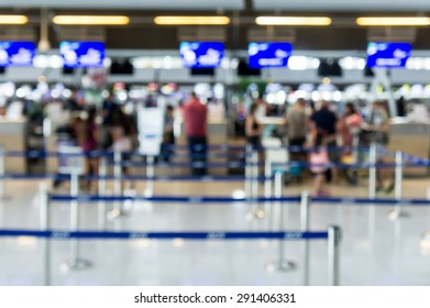 Abstract Blur Background : Airport Check-In Counters With Passengers And Crowd Control Barriers With Bokeh