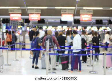Abstract Blur Background , Airport Check-In Counters With Many Passengers With Bokeh