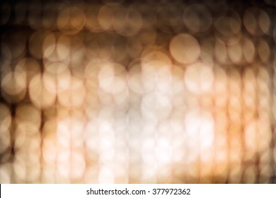 Abstract blur background of aluminum foil. Warm tone.