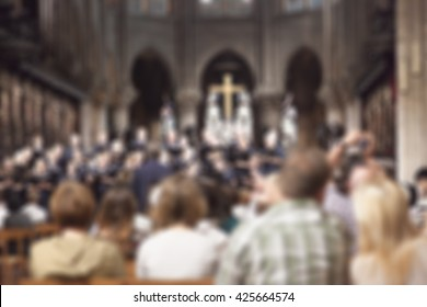 abstract blur background of a band is singing with audience in a church