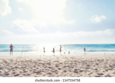 abstract blur background of beach and people enjoying sunny weather
