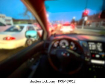 Abstract blur background of car interior at red light.