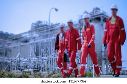 Abstract, blur background, defocusing - image for the background. Business partners. Industrial worker on the assembly and maintenance at the refinery production of gasoline