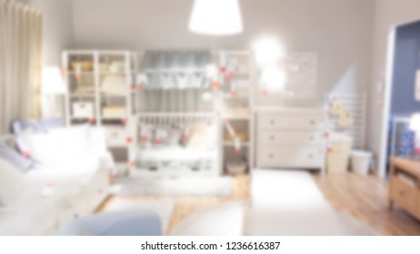 abstract blur background of furniture store - can use to display or montage on product. abstract blur furniture store background. blur picture background of bedroom display showroom in furniture mall