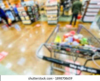 Abstract blur background of grocery store cart at checkout lane.