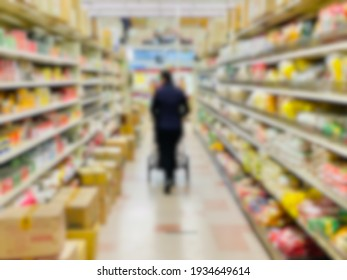 Abstract blur background of a grocery store shopper walking.