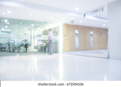 Abstract blur background a Man wait for somone see the doctor Hope for good with luxury clinic or hospital interior.