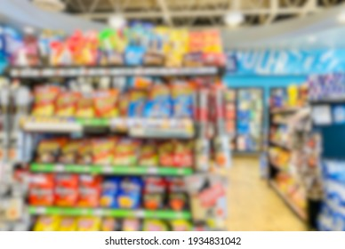 Abstract blur background of market shelves filled with merchandise.
