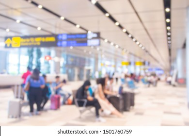 Abstract Blur Background of Passengers in Airport Interior Waiting Hall Departure/arrival Lounge Modern Terminal at Singapore Changi Airport. Concept: Transport/Travel.