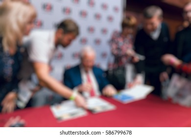 Abstract blur background of people in group meeting in convention hall