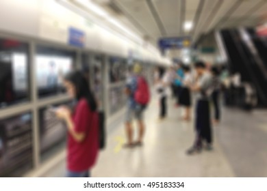 Abstract blur background of people queue waiting for train in subway station in Bangkok Thailand.