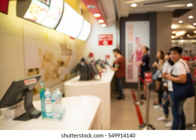 Abstract Blur Background People Wait to Order food and make Payment in Fastfood Store or Seflservice Restaurant