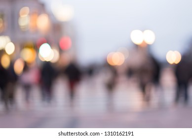 abstract blur background of people walking in a street at night