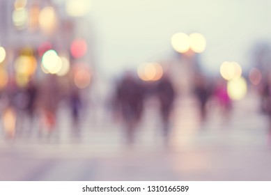 abstract blur background of people walking in a street
