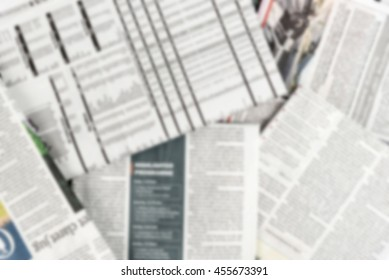 Abstract blur background of pile of newspaper.