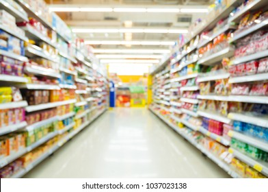 Abstract blur Background of Shelf of Snack and Candy in Grocery goods section in Supermarket or Hypermarket Convenience Store as shopping Concept.