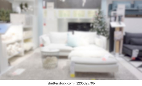 abstract blur background of sofa in livingroom discount store - display or montage on product. Blur White sofa set for home decoration