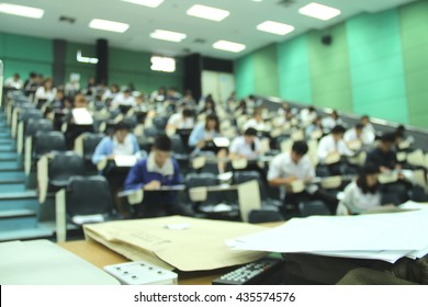 Abstract blur background of student during study or quiz, test and exams from teacher or in large lecture room / University classroom.