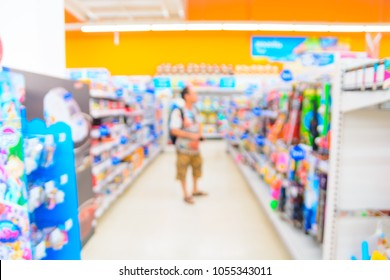 Abstract Blur Background of Supermarket or Hypermarket Retail Store Outlet at Kids or Toys Section as Toys Selection or Modern Lifestyle Shopping Concept.