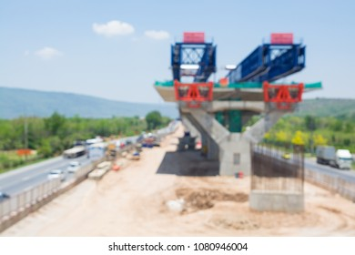 Abstract Blur Background of Under construction Highway, Autoroute or Expressway in Thailand.  Construction site is higher over normal Street.