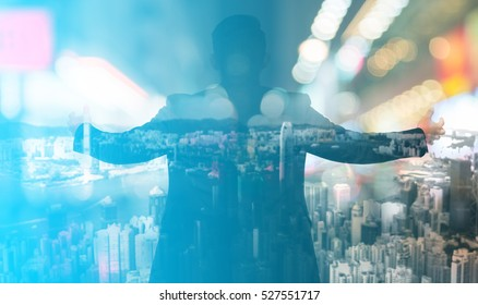 Abstract blur background.Double exposure of Young Asian businessmen feeling acting freedom and city. business freedom concept.