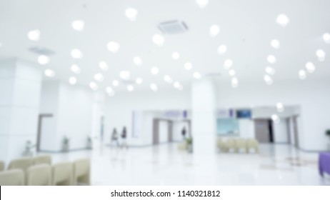 Abstract blur of beautiful modern outpatient clinic of hospital hall with many light for background