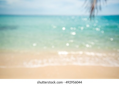 Abstract blur beautiful tropical island beach with sunlight background summer holiday concept