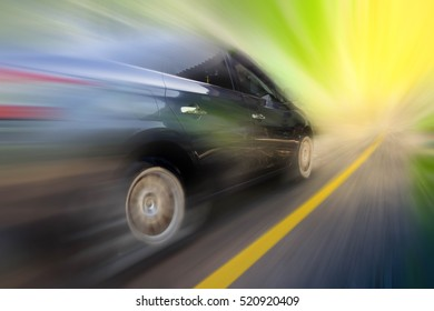 abstract blur black speeding car on the road at sunset light