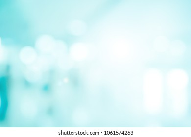 abstract blur blue color contemporary office corridor interior background with shine light filter for power point presentation concept