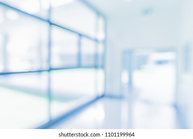 Abstract blur blue tone image of bright and clean Window , Door and corridor in modern office building on day time for background usage.