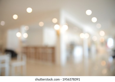 Abstract blur bokeh background or defocused cafe or coffee shop  interior for design in your work backdrop concept.