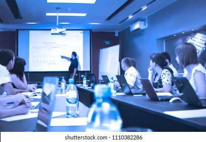 Abstract, blur, bokeh background, defocusing - image for the background. Businessman standing in front of presentation, business people discussing in conference training or learning coaching Concept.