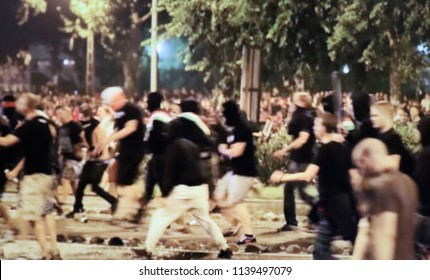Abstract, blur, bokeh background, defocusing - image for the background.Protesters During illegal protest action and riots.