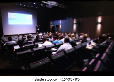 Abstract, blur, bokeh background, defocusing - image for the background. Speaker giving a talk in conference hall at business event. Audience at  conference hall. Business and Entrepreneurship concept