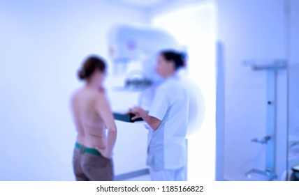 Abstract, blur, bokeh background, defocusing - image for the background. Woman undergoing medical mammography scan.