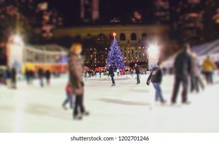 Abstract, blur, bokeh background, defocusing - image for the background. Rink. Christmas skating.